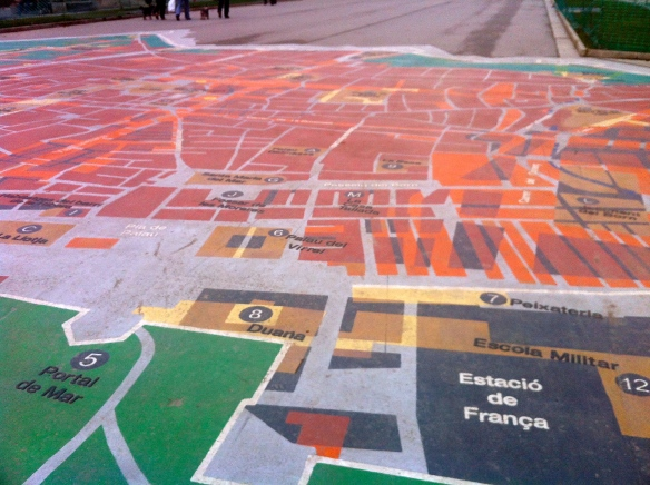 A map of the city center, painted on the ground near the Arc de Triomphe